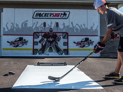 400x300 hockeyshot crowdgoeswild shooting tarp.jpg?ch=width%2cdpr%2csave data&auto=format%2ccompress&dpr=2&format=jpg&w=250&h=187