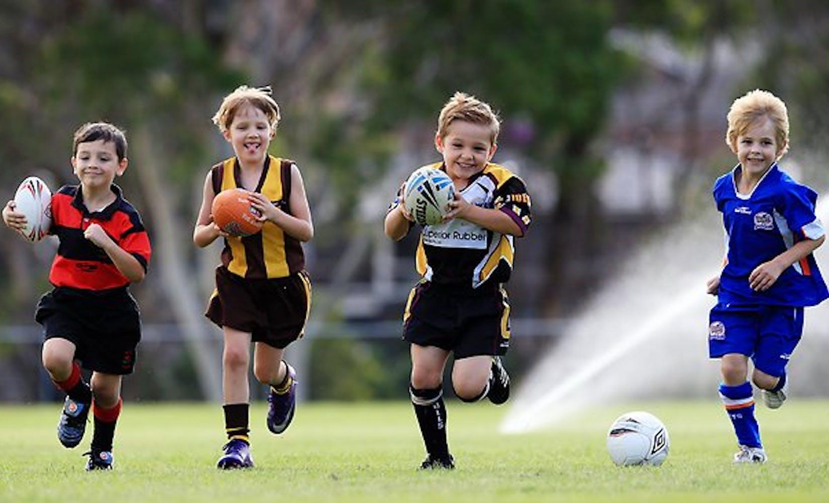 248917 children playing footy